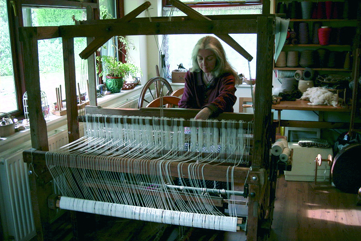 Shirley working on one her large looms