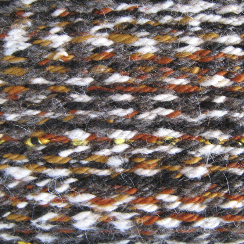 Rug with coloured highlights emulating Red Kite plumage