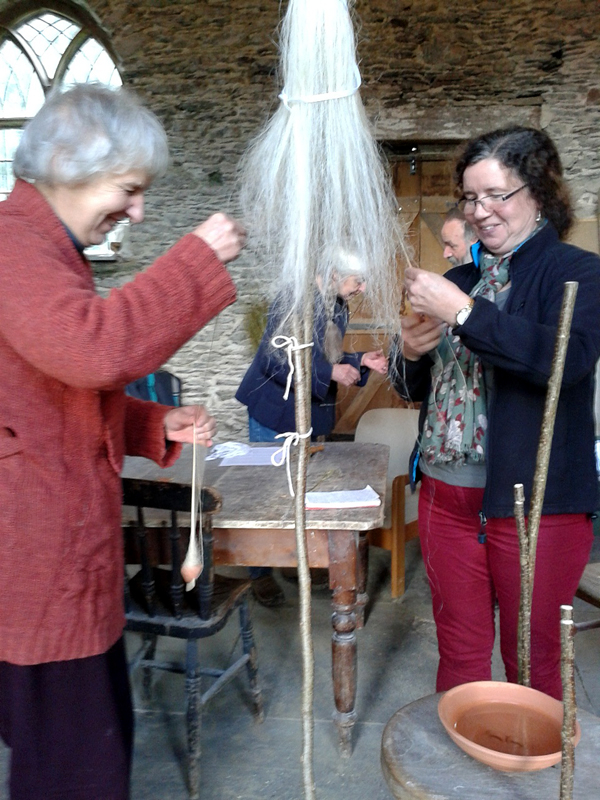 Spinning flax on spindles